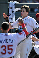 Right fielder Tate Matheny (16) of the Greenville Drive is congratulated after scoring a run in a game against the Columbia Fireflies on Sunday, May 8, 2016, at Fluor Field at the West End in Greenville, South Carolina. Greenville won, 5-4. (Tom Priddy/Four Seam Images)