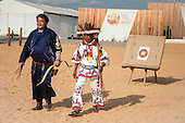 A Mongolian and a Mexican contestant recover their arrows from the target during archery practice at the International Indigenous Games in Brazil. 28th October 2015