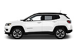 Car driver side profile view of a 2018 Jeep Compass Limited 4WD 5 Door SUV