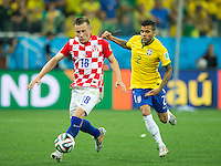 Ivica Olic of Croatia and Dani Alves of Brazil