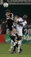 August 31, 2005: Washington, DC, USA:  .DC United midfielder Ben Olsen (14) is pushed on a header by   Real Salt Lake forward Mevin Tarley (14) at RFK Stadium  (c) Copyright 2005 Brad Smith.