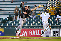 Jupiter Hammerheads first baseman Thomas Rowan (26) gets pulled off the bag by an errant throw as Endy Rodriguez (5) runs through the bag during a game against the Bradenton Marauders on June 26, 2021 at LECOM Park in Bradenton, Florida.  (Mike Janes/Four Seam Images)