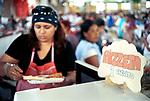 Economic Turmoil in Argentina<br /> A woman serves Pizza, which costs 1 Trueque credit. Trueque market Bernal Buenos Aires. 2000s 2002