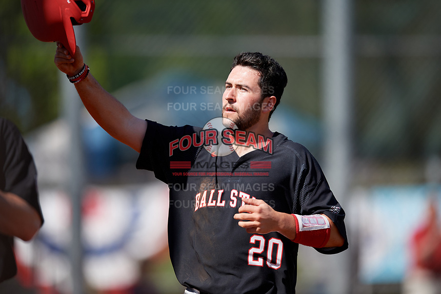 Ball State Cardinals catcher Chase Sebby (20) celebrates after scoring a run during a game against the Saint Joseph's Hawks on March 9, 2019 at North Charlotte Regional Park in Port Charlotte, Florida.  Ball State defeated Saint Joseph's 7-5.  (Mike Janes/Four Seam Images)