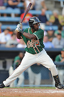 Greensboro Grasshoppers right fielder Marcell Ozuna #34 swings at a pitch during the first game of a double header against the Asheville Tourists at McCormick Field on July 26, 2011 in Asheville, North Carolina. Asheville won the game 12-4.   (Tony Farlow/Four Seam Images)