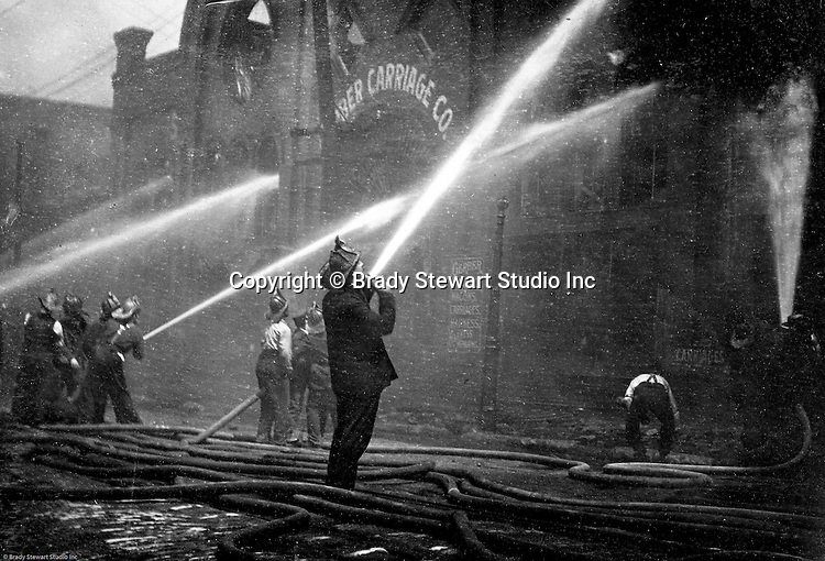 Pittsburgh PA:  View of Pittsburgh firefighters fighting a fire at a Carriage factory.