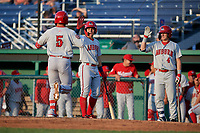 Auburn Doubledays Anthony Peroni (5) is congratulated at home by Ricardo Mendez (3) and J.T. Arruda (4) after hitting a home run during a NY-Penn League game against the Batavia Muckdogs on June 18, 2019 at Dwyer Stadium in Batavia, New York.  Batavia defeated Auburn 7-5.  (Mike Janes/Four Seam Images)