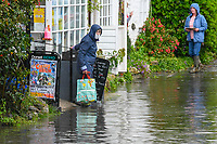 Floody hell – Dorset gets a soaking leaving villagers wading to the shop.