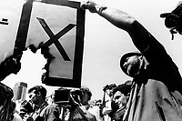 A white man urges people not to vote in the upcoming elections, the country's first multiracial election after the end of apartheid, at a right-wing rally in Pretoria.