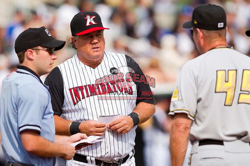 Kannapolis Intimidators manager Tommy Thompson #39 and West Virginia Power manager Gary Robinson #45 meet at home plate with umpire Blake Felix prior to the start of the game at Fieldcrest Cannon Stadium on April 20, 2011 in Kannapolis, North Carolina.   Photo by Brian Westerholt / Four Seam Images