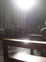 """""""The Light""""            A single ray of light suddenly appears through the dome, illuminating those praying at St. Peter's Basilica"""