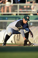 South Bend Silver Hawks first baseman Daniel Palka (24) picks a throw during a game against the Lansing Lugnuts on June 6, 2014 at Cooley Law School Stadium in Lansing, Michigan.  South Bend defeated Lansing 13-5.  (Mike Janes/Four Seam Images)