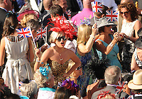 Racegoers join in the traditional communal singing around the bandstand after the racing has finished, on Ladies Day, the third day of Royal Ascot.