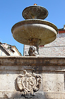 Assisi: A close view of the fountain in the main square of the historical center (the communal square), with its emblem. This is a slight enlargement of part of the original image.