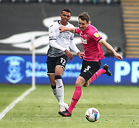 1st May 2021; Liberty Stadium, Swansea, Glamorgan, Wales; English Football League Championship Football, Swansea City versus Derby County; Morgan Whittaker of Swansea City and Craig Forsyth of Derby County challenge for the ball