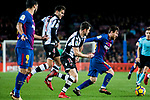 Lionel Andres Messi (R) of FC Barcelona fights for the ball with Sergio Postigo Redondo (2nd R) of Levante UD during the La Liga 2017-18 match between FC Barcelona and Levante UD at Camp Nou on 07 January 2018 in Barcelona, Spain. Photo by Vicens Gimenez / Power Sport Images