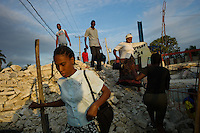 Port au Prince, Haiti, April 16, 2010.Early morning scenes near 'Portail Leogane' a popular transport terminal. The scars of the January earthquake are everywhere to be seen.