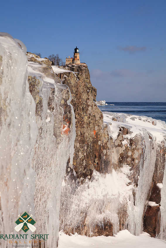 """""""Superior Ice at Split Rock Lighthouse""""<br /> Winter winds and waves create natural ice sculptures along Lake Superior's rugged shoreline. This unique perspective of the well-loved lighthouse highlights the naturally beautiful shore."""
