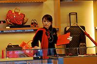A Louis Vuitton sales lady, Tokyo, Japan..