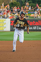 Roger Kieschnick (33) of the Salt Lake Bees hustles towards third base against the Iowa Cubs in Pacific Coast League action at Smith's Ballpark on August 21, 2015 in Salt Lake City, Utah. The Bees defeated the Cubs 12-8.  (Stephen Smith/Four Seam Images)