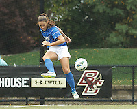 Duke University forward/midfielder Avery Rape (13) volley pass.Boston College (white) defeated Duke University (blue/white), 4-1, at Newton Campus Field, on October 6, 2013.