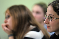 College students listening intently in class.