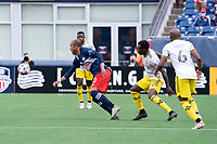 FOXBOROUGH, MA - MAY 16: Teal Bunbury #10 of New England Revolution breaks to intercept a high ball during a game between Columbus SC and New England Revolution at Gillette Stadium on May 16, 2021 in Foxborough, Massachusetts.