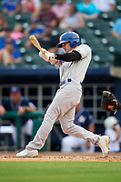Midland RockHounds third baseman Jordan Tarsovich (5) follows through on a swing during a game against the Northwest Arkansas Naturals on May 27, 2017 at Arvest Ballpark in Springdale, Arkansas.  NW Arkansas defeated Midland 3-2.  (Mike Janes/Four Seam Images)