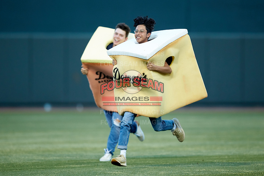 """Fans compete in the """"Dewey's Cake Race"""" between innings of the Carolina League game between the Down East Wood Ducks and the Winston-Salem Dash at BB&T Ballpark on May 10, 2019 in Winston-Salem, North Carolina. The Wood Ducks defeated the Dash 9-2. (Brian Westerholt/Four Seam Images)"""