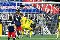 FOXBOROUGH, MA - OCTOBER 3: Incoming header from Tajon Buchanan #17 of New England Revolution for Joe Willis #1 of Nashville SC during a game between Nashville SC and New England Revolution at Gillette Stadium on October 3, 2020 in Foxborough, Massachusetts.