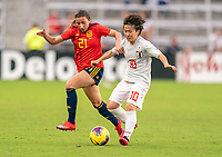 ORLANDO, FL - MARCH 05: Sheila Garcia #21 of Spain fights for the ball with Yuka Momiki #10 of Japan during a game between Spain and Japan at Exploria Stadium on March 05, 2020 in Orlando, Florida.