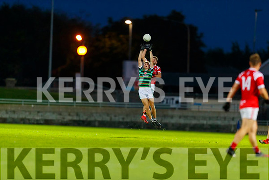 Diarmuid O'Connor, St. Brendan's Board in action against Brendan O'Keeffe, East Kerry during the Kerry County Senior Football Championship Semi-Final match between East Kerry and St Brendan's at Austin Stack Park in Tralee, Kerry.