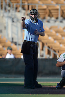 Home plate umpire Seth Buckminster during an Arizona Fall League game between the Glendale Desert Dogs and Mesa Solar Sox on October 8, 2013 at Camelback Ranch Stadium in Glendale, Arizona.  The game ended in an 8-8 tie after 11 innings.  (Mike Janes/Four Seam Images)