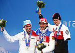 Sochi, Russia, 12/03/2014. Canadian Biathlete Mark Arendz celebrates his bronze medal win in the 12.5km standing event at the Sochi 2014 Paralympic Winter Games in Sochi Russia with gold medalist Azat Karachurin of Russia and silver medalist Nils-Erik Ulset of Norway (Photo Scott Grant/Canadian Paralympic Committee)