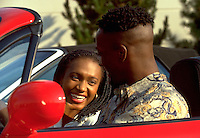 African-American Male and Female (Couple) laughing in red convertible sports car; romance, dating, Black, man, woman 4x5 orig. Kim Mayes, Rashaan Davis.