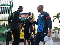 Kingston, Jamaica - Thursday, June 6, 2013: Donovan Ricketts and Tim Howard great each other before USMNT training at the National Stadium.