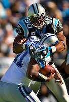 Carolina Panthers defensive end Julius Peppers (90) tackled Detroit Lions quarterback Daunte Culpepper (11) during an NFL football game at Bank of America Stadium in Charlotte, NC.
