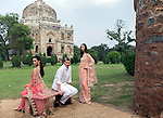 8 October 2013, New Delhi, India. Recently retired Australian cricket star Brett Lee poses in front of a Mughal era tomb in the famous Lodi Gardens in New Delhi with a pair of models. He is in India to show off his latest fashion lines and to foster greater interest in Australian - Indian business interactions.  Picture by Graham Crouch