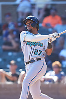 Salt River Rafters Jerar Encarnacion (27), of the Miami Marlins organization, hits a grand slam during the Arizona Fall League Championship Game against the Surprise Saguaros on October 26, 2019 at Salt River Fields at Talking Stick in Scottsdale, Arizona. The Rafters defeated the Saguaros 5-1. (Zachary Lucy/Four Seam Images)
