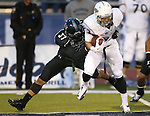 Nevada's Joseph Huber (83) fights to break free from Hawaii's Charles Clay (37) during the second half of an NCAA college football game in Reno, Nev., on Saturday, Sept. 21, 2013. Nevada won 31-9. (AP Photo/Cathleen Allison)