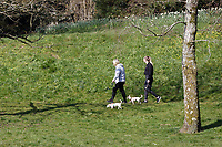 Pictured: Two women walk their dogs in Singleton Park in Swansea, Wales, UK. Friday 27 March 2020<br /> Re: Covid-19 Coronavirus pandemic, UK.
