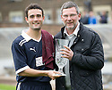 Raith Rovers' Laurie Ellis is presented with some crystal from Scotland boss Craig Levein to commemorate his testimonial