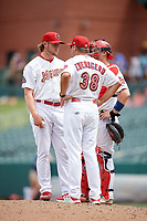 Memphis Redbirds relief pitcher Rowan Wick (33) listens to pitching coach Bryan Eversgerd on the mound during a game against the Iowa Cubs on May 29, 2017 at AutoZone Park in Memphis, Tennessee.  Memphis defeated Iowa 6-5.  (Mike Janes/Four Seam Images)