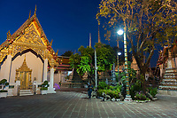 Night photo of Buddist temple Phra Maha Chedi in Bangkok, Thailand