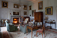 The family sitting room, warmed by the light of a log fire