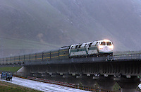 A train passes over a bridge in driving rain on the Tibet railway in Toling Valley, Tibet, China. Some 3% of the route between Golmud in Qinghai province and Lhasa in Tibet is composed of bridges and tunnels, according to official figures. .08 Jul 2006