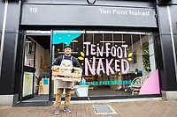 BNPS.co.uk (01202) 558833<br /> Pic: WillDax/BNPS<br /> <br /> Pictured: Daniel Pink, the runs Zero waste grocery store and refill service called, 'Ten Foot Naked in Poole'<br /> <br /> A complex of ten small independent businesses that are not paying rent or business rates could hold the answer for saving the British high street.<br /> <br /> Kingland is an ambitious initiative aimed at breathing new life into the struggling town centre in Poole, Dorset, which people said had become like a 'ghost town'.<br /> <br /> The new development has been billed as a 'boutique shopping experience' and the owners of the small independents do not have to pay any rent or business rates for the first two years.<br /> <br /> The shops offer a diverse range with a fishmonger, zero waste grocery store, custom surfboard maker, coffee shop, gallery, restored furniture shop, fragrance shop, plant and interiors shop, design studio and a gin bar and shop.