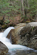 "Franconia Notch State Park - The Pemigewasset River in the area of ""The Basin"" viewing area in Lincoln, New Hampshire USA during the spring months"