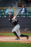 Lansing Lugnuts right fielder Edward Olivares (1) follows through on a swing during a game against the Clinton LumberKings on May 9, 2017 at Ashford University Field in Clinton, Iowa.  Lansing defeated Clinton 11-6.  (Mike Janes/Four Seam Images)