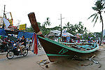 A Thai boat that washed on shore sits in the middle of the street with debris after tsunamis hit Patong Beach on Phuket Island, Thailand. On December 26, 2004, a major earthquake generated tsunamis that ravaged coastlines from Southeast Asia to Africa. Approximately 275,000 people were killed and tens of thousands were left homeless, making it one of the deadliest natural disasters in modern history.